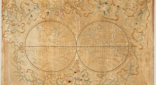 The image shows two globes connected by a line through the middle. The picture is framed by beautiful flowers.
