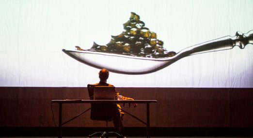 A person watching a film projection