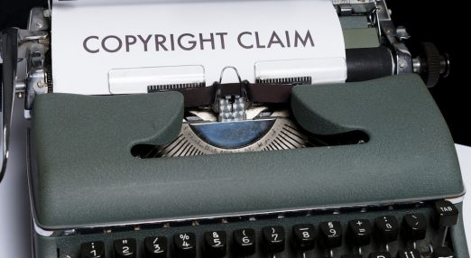 "A typing machine printing a doscument saying ""Copyright Claim"""