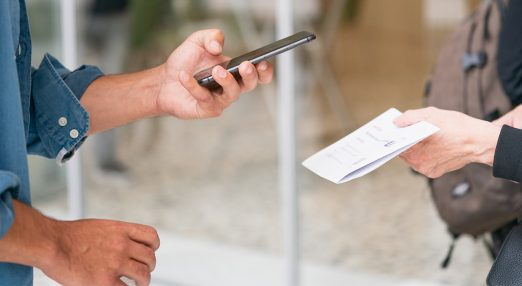 A man using his phone to scan a document