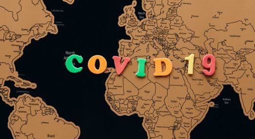 """A map of Europe and the """"Covid 19"""" sign on it"""